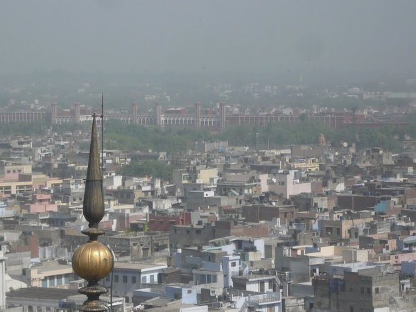 A picture of the rooftops and distant hazy skyline of Old Delhi